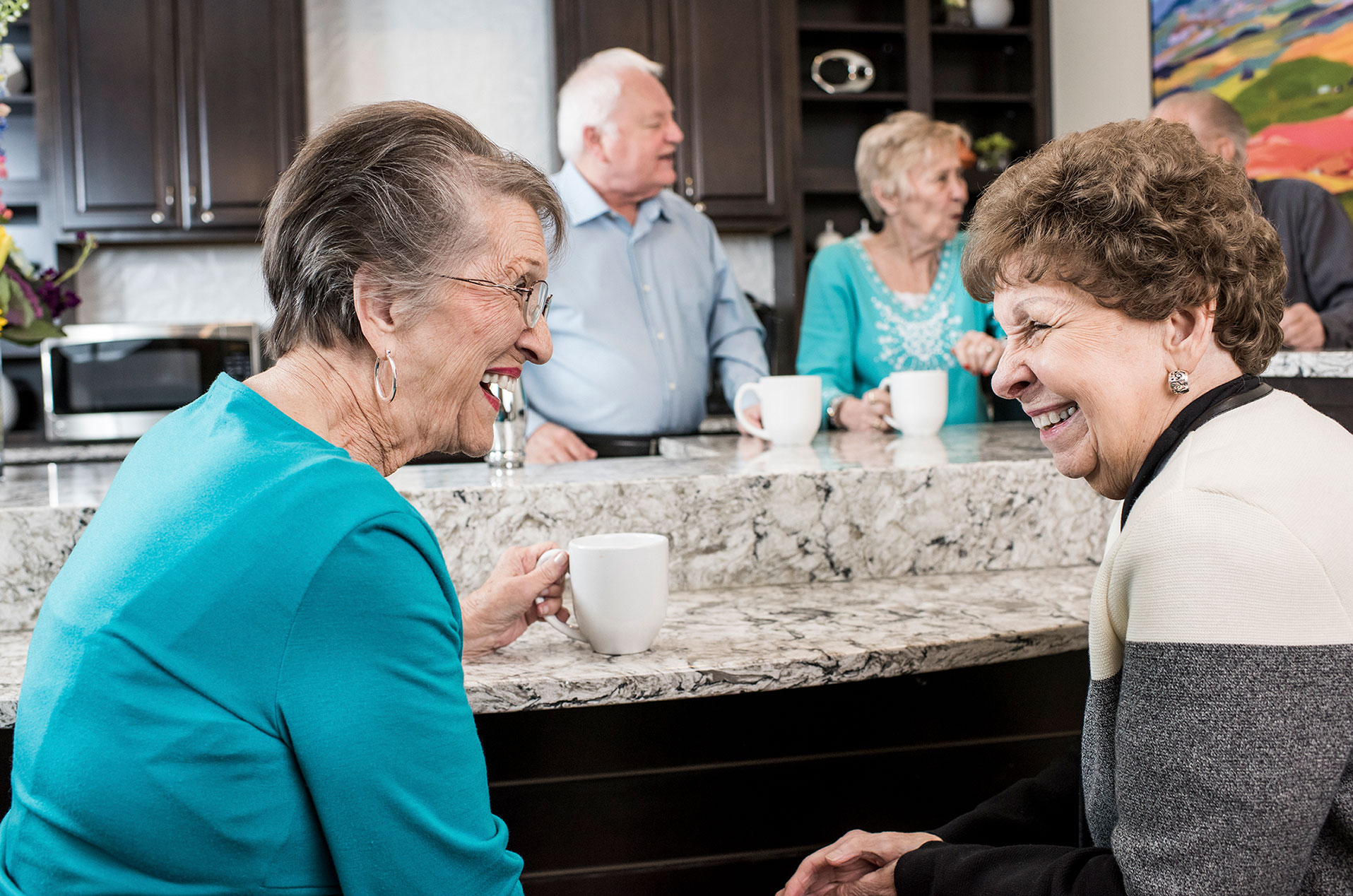 Residents Laugh While One Holds A Coffee